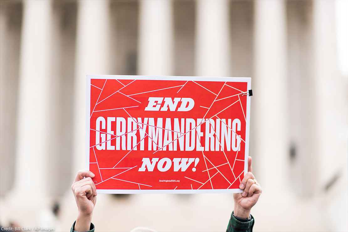 Gerrymandering activists gather on the steps of the Supreme Court as the court prepares to hear the the Benisek v. Lamone case on Wednesday, March 28, 2018.